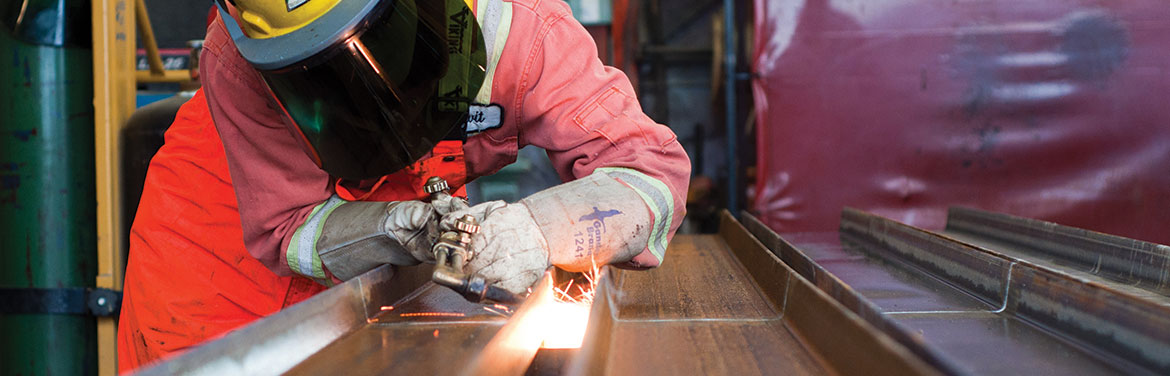 A women welding in a welding shop