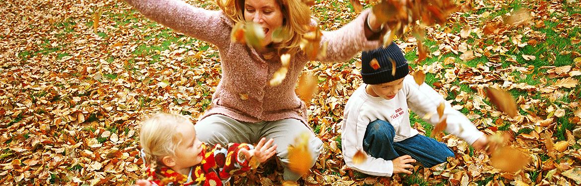 Playing in leaves with children